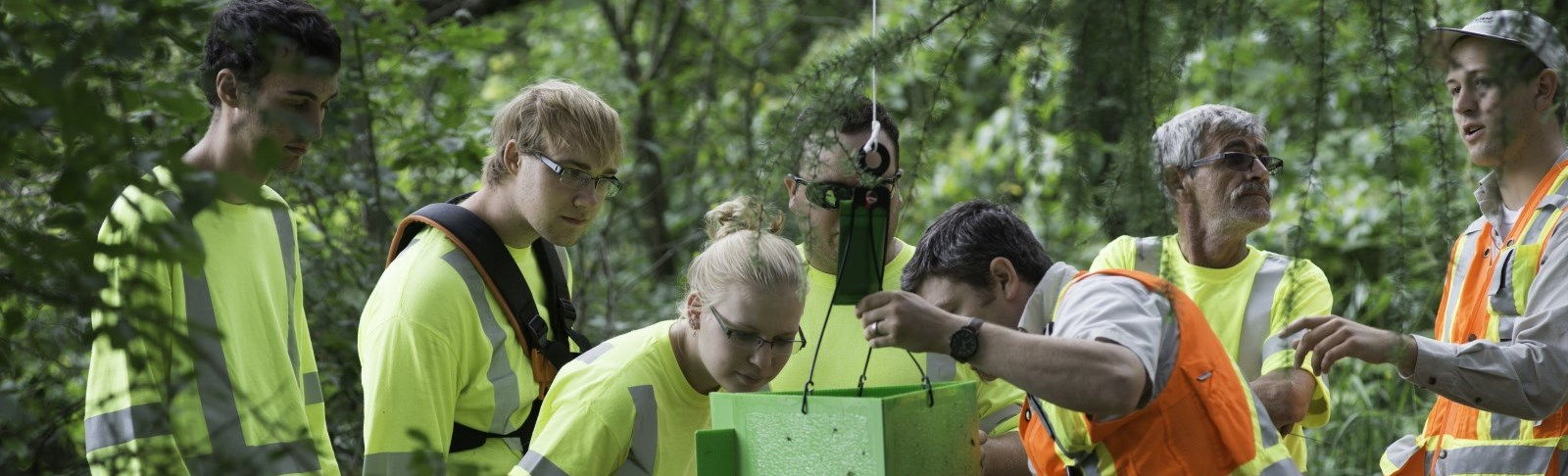 Forest staff demonstrating equipment to students
