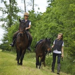 2 people horseback riding
