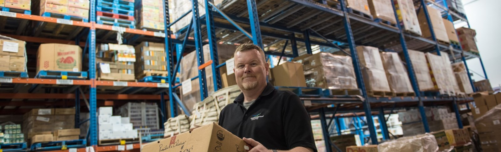 Man holding box in warehouse