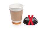 coffee cup with lid beside